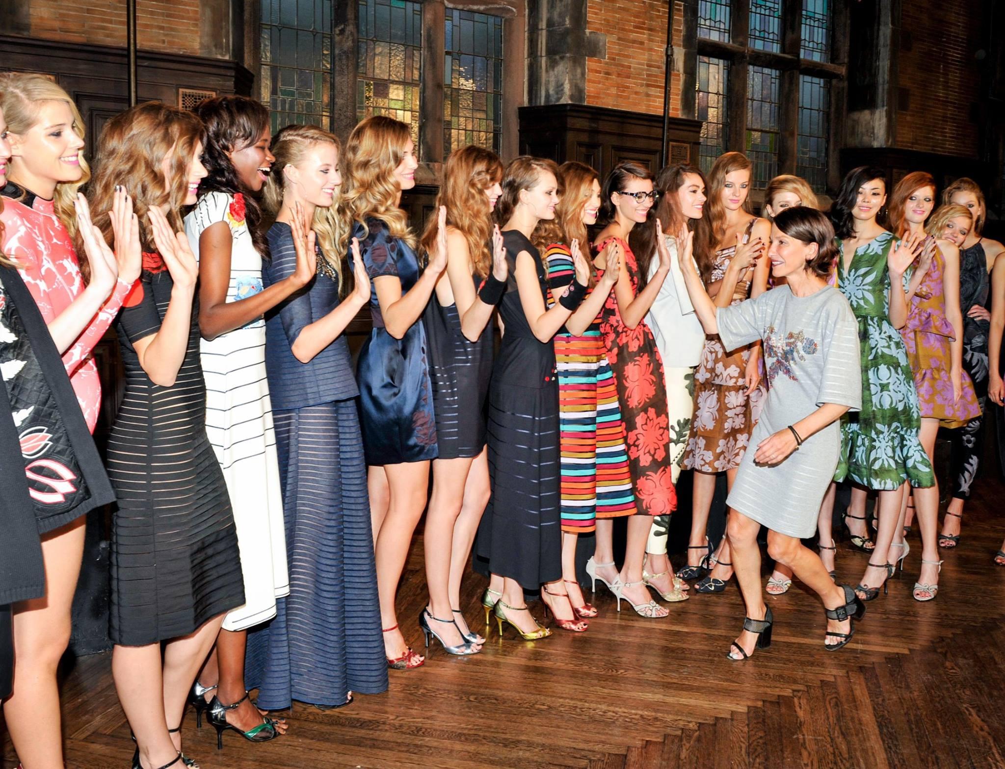 Rowley high-fives models wearing her spring designs. Image via Cynthia Rowley/Facebook