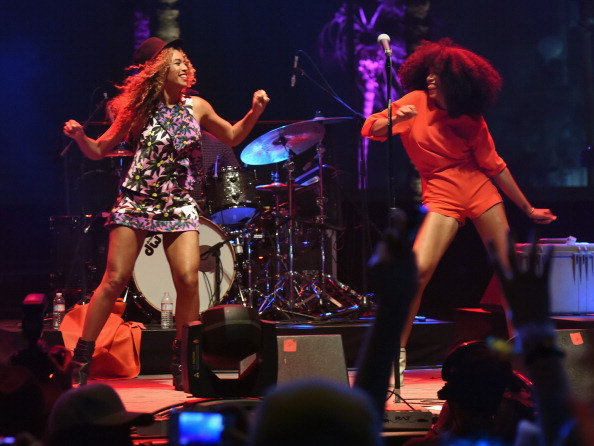 Beyoncé and Solange on stage at Coachella, via Getty