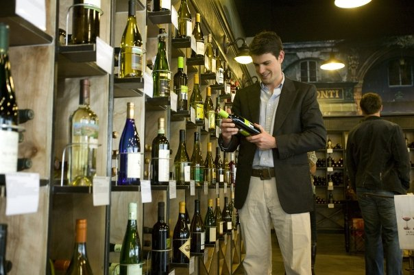 At Grand Cru, he's sure to bring home the right bottle of wine. Image via Grand Cru