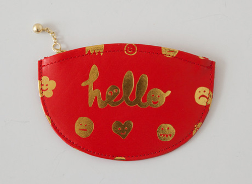 """<a href=""""http://covetandlou.com/collections/accessories/products/paris-house-the-goodies-and-the-baddies-half-moon-in-ruby"""">The Goodies and the Baddies Half Moon wallet by Paris House</a>, $78 at Covet + Lou"""