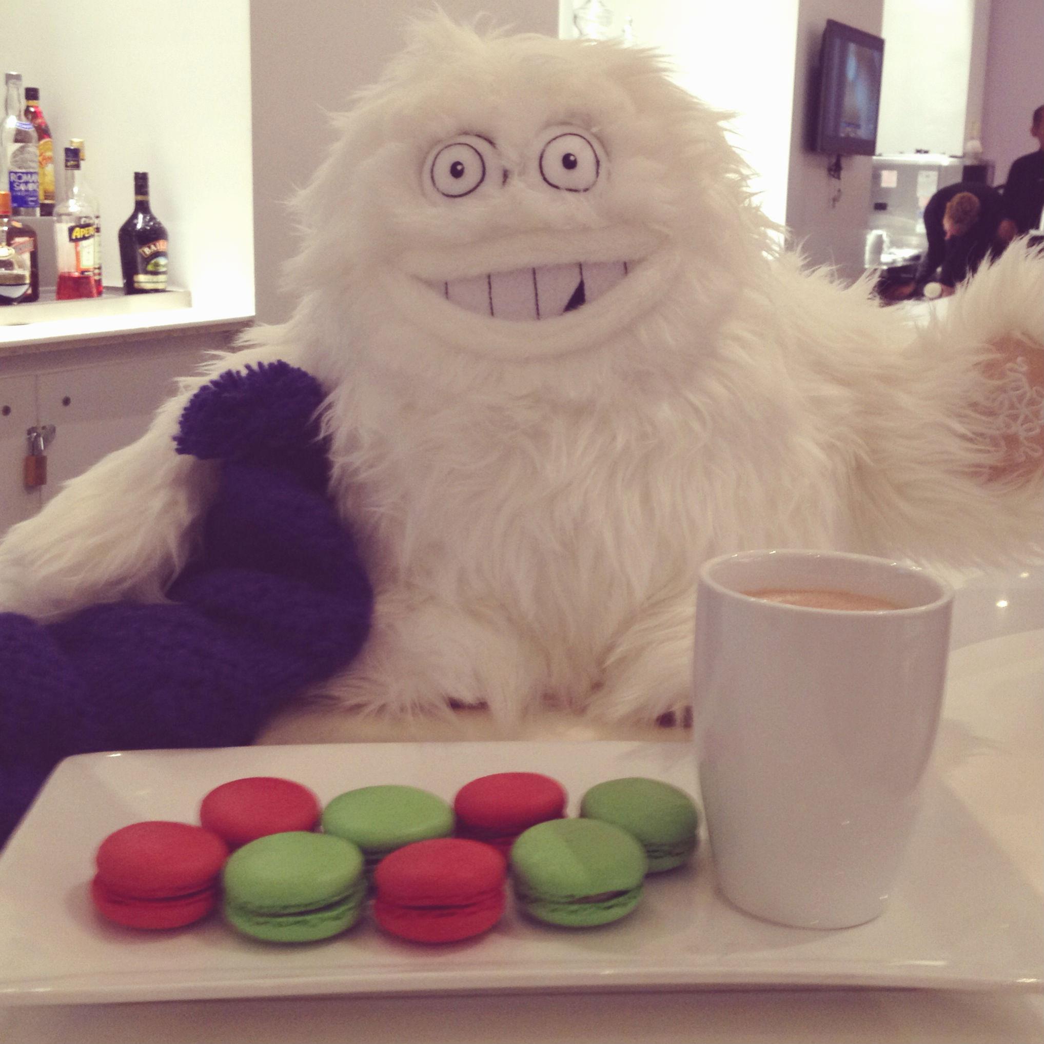 The Saks Yeti enjoying macarons and hot cocoa at SnAKS, the cafe at Saks