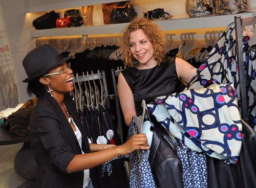 """Van Aken (right) and a customer at SA VA. Image credit: R. Kennedy for <a href=""""http://press.visitphilly.com/media/show/id/2424/indice/51"""">GPTMC</a>"""