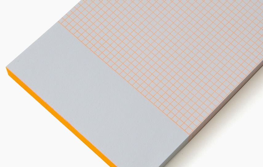 "Le Typographe Mini Bloc notebook in orange. Image via <a href=""http://www.shop-rikiki.de/shop/en/Le-Typographe/Mini-Bloc-6pt.html"">Rikiki</a>"