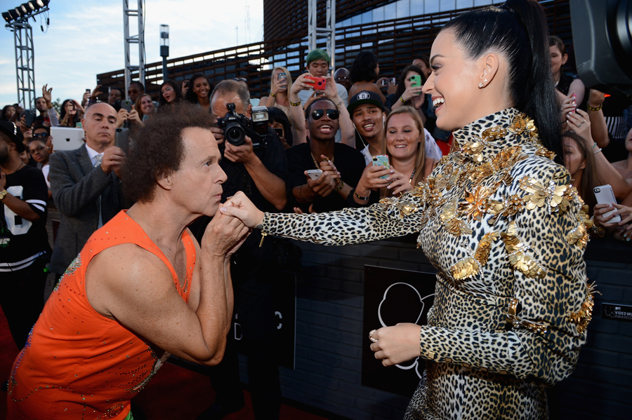 Richard Simmons and Katy Perry. Photos via Getty Images