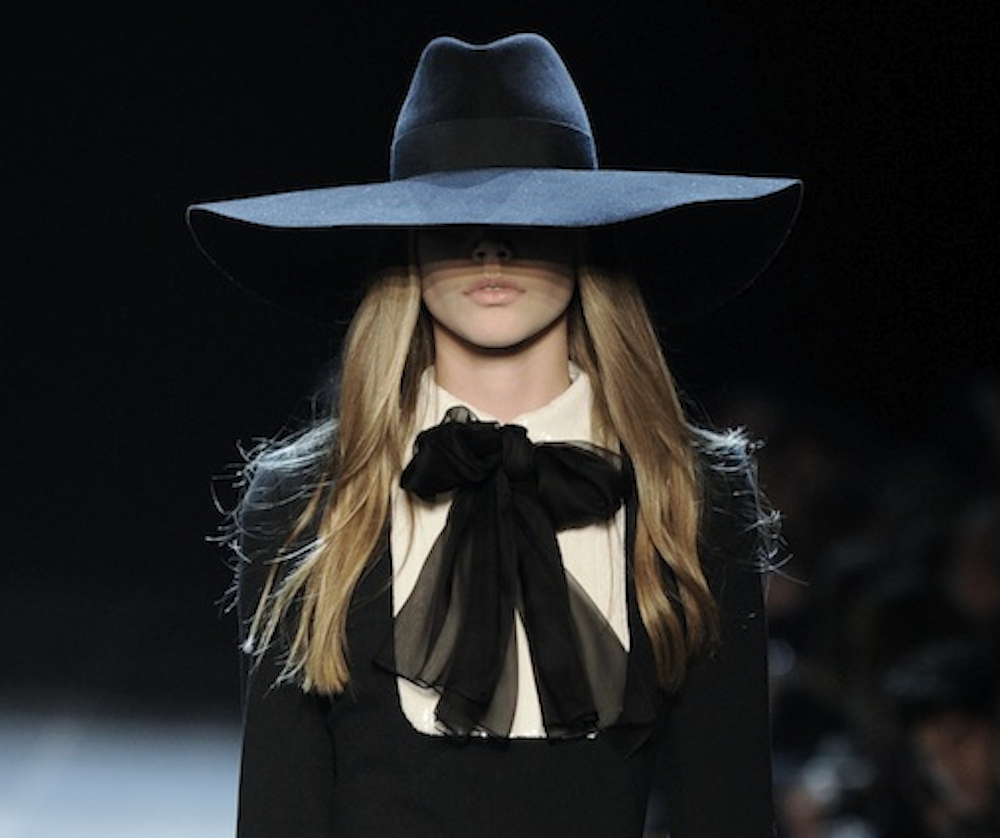 This look (minus the hat) is hung inside a glass case