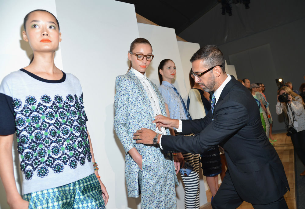 Tom Mora putting the finishing touches on J.Crew's women's Spring 2013 presentation in NYC. Photo via Getty Images.