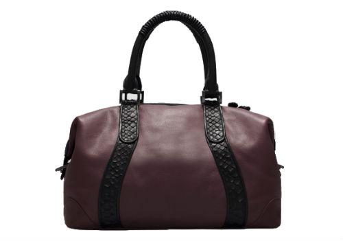 "The <a href=""http://khirmaeliazov.com/shop2.php/handbags/oxblood-leather-angela.html"">Angela Mini Duffle</a> in Oxblood"