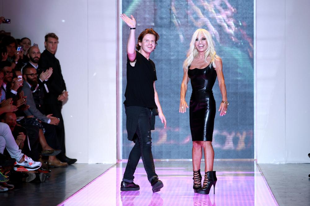 Kane and Versace on the Versus runway in Milan last month. Via Getty Images.