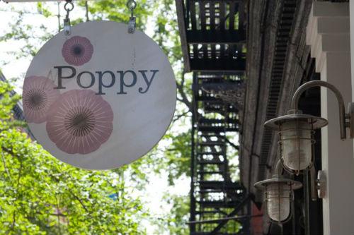 """Poppy's Nolita signage via <a href=""""http://www.yelp.com/biz_photos/uTZLhW5euTiGoqWc6Ao2_w?select=RlevhLXHmscgXfIkA8xZLw#RlevhLXHmscgXfIkA8xZLw"""">Yelp</a>"""