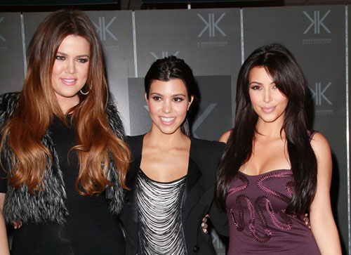 Khloe, Kourtney and Kim Kardashian. Photo via Getty Images.
