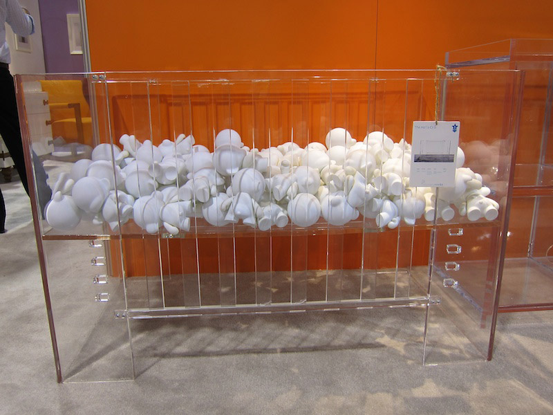 """The Vetro (then called the Hollis) filled with Munny dolls. Image via <a href=""""http://blogs.babble.com/family-style/2010/10/13/yes-what-youre-looking-at-is-a-3000-acrylic-crib/"""">Babble</a>"""
