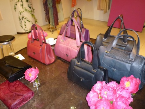 The pouch clutches (the black one holds an iPad, too), plus the complete line of handbags starting at $2300 for basic leather.