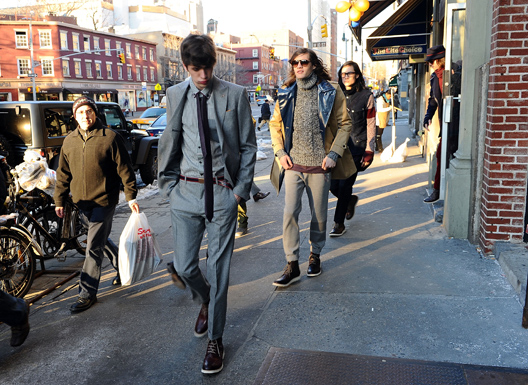 Male models head to Tommy Hilfiger's fall 2011 show. Via Getty