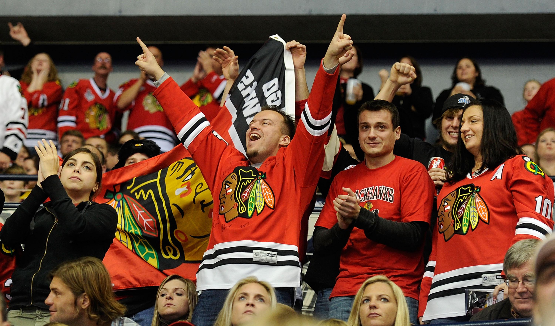 Blackhawks fans celebrate a Chicago goal in Nashville in November 2010.