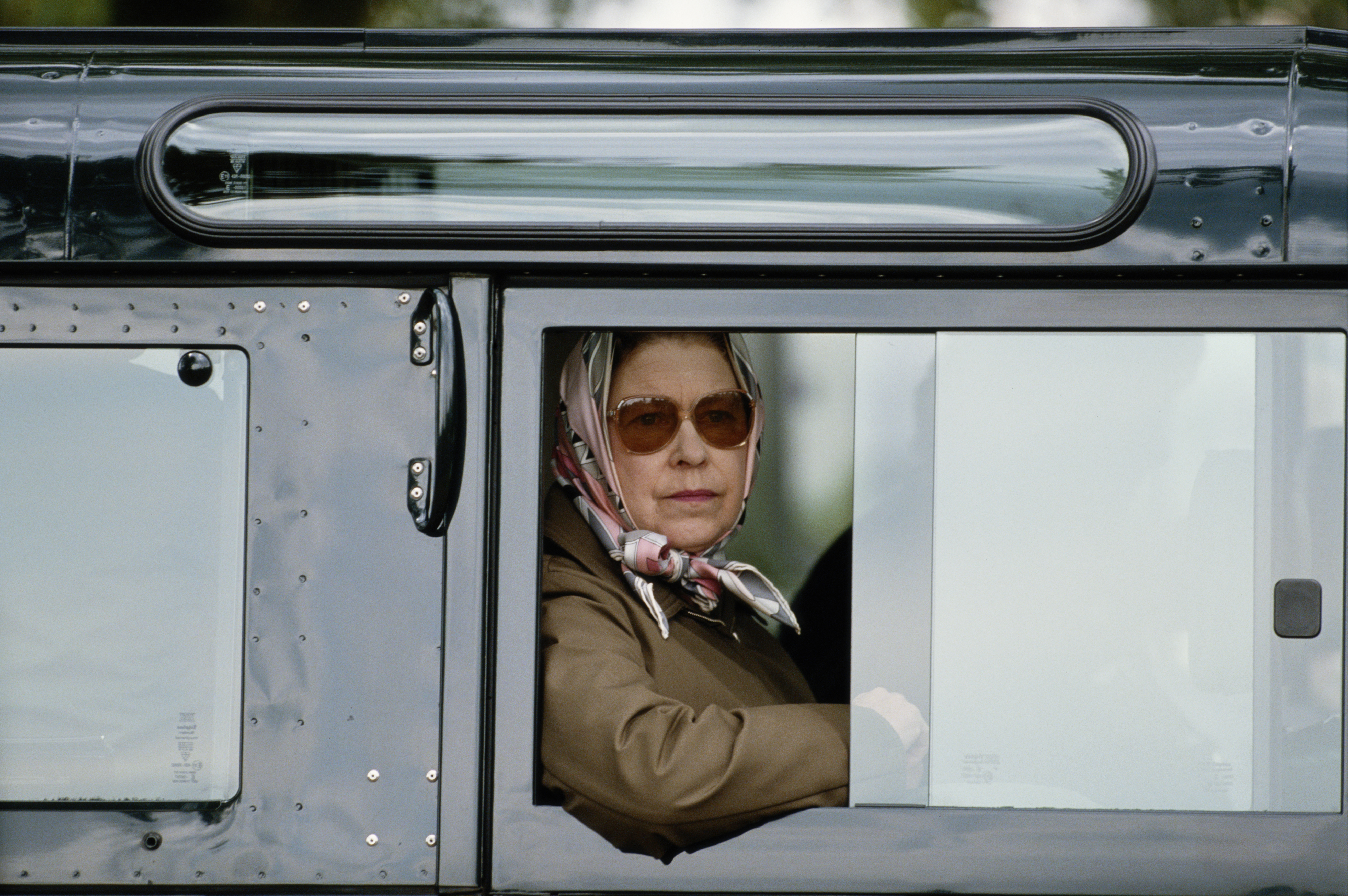 """""""You're damn right one is driving oneself."""" Queen Elizabeth in her Land Rover in 1987."""