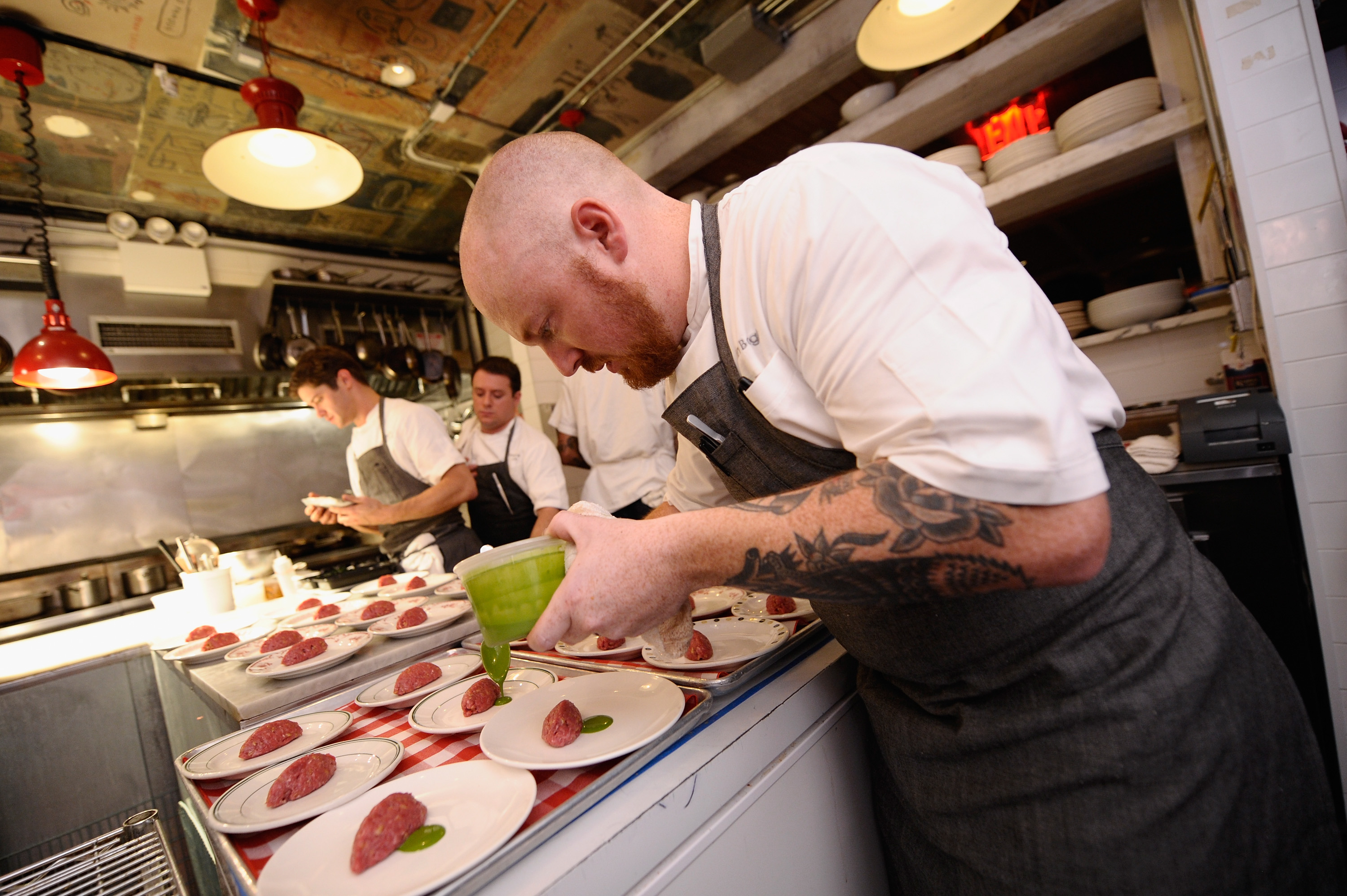 Bogle plating a dish for an event at the Food Network NYC Wine & Food Festival, October 16, 2014.