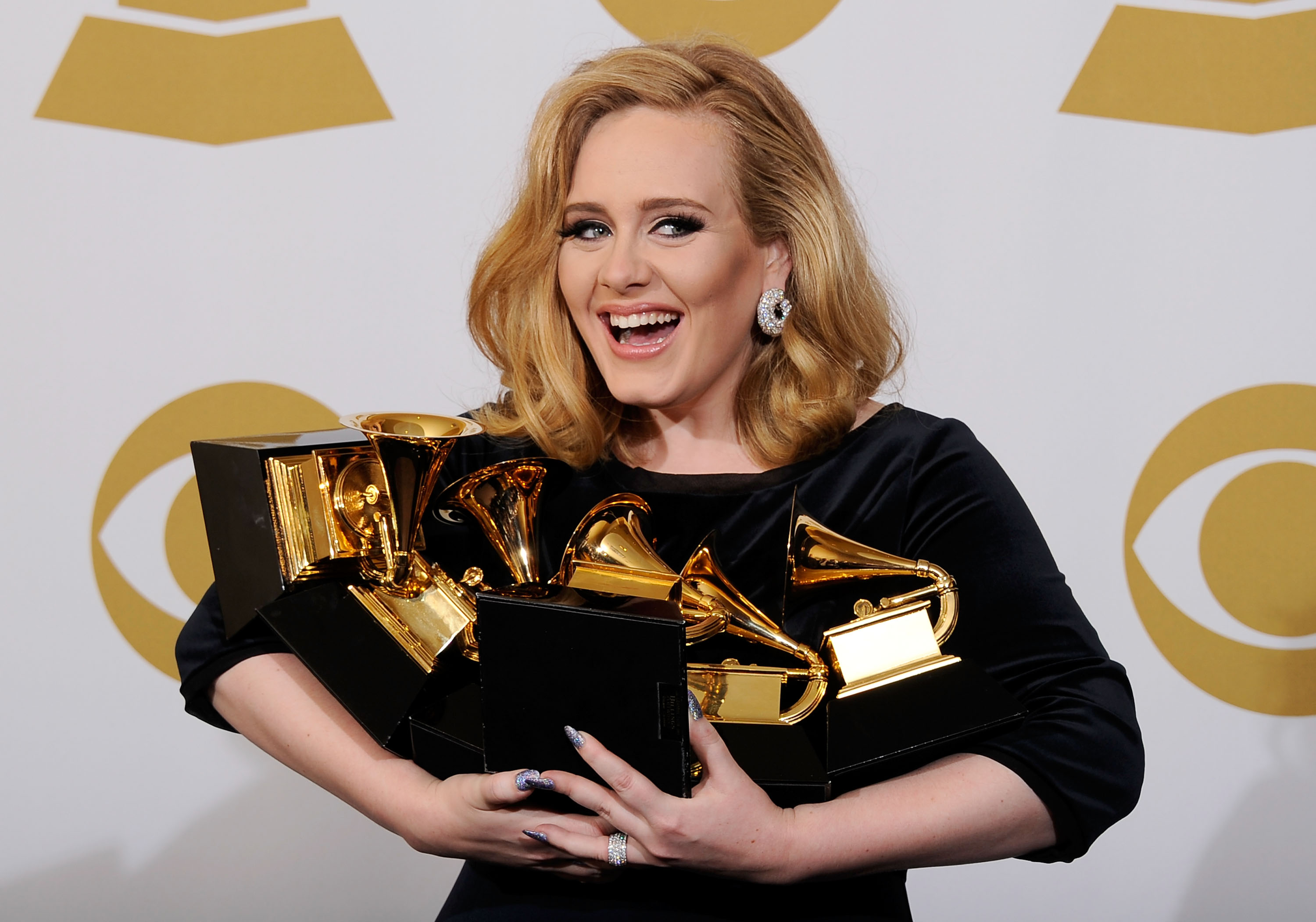 Adele with her slew of Grammys in 2012