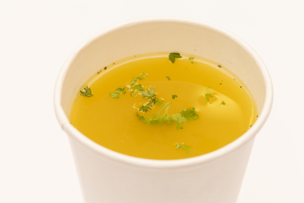 Chicken stock in a cup.