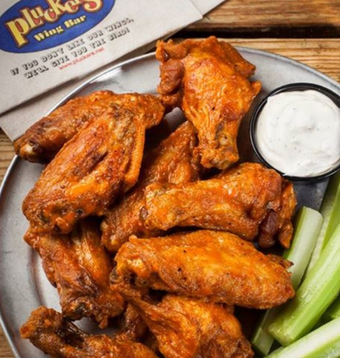 Partake of wings at rolled back pricing during Pluckers' 20th anniversary.