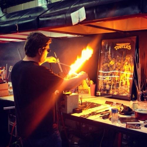 Chef Jesse Knott blowing glass.