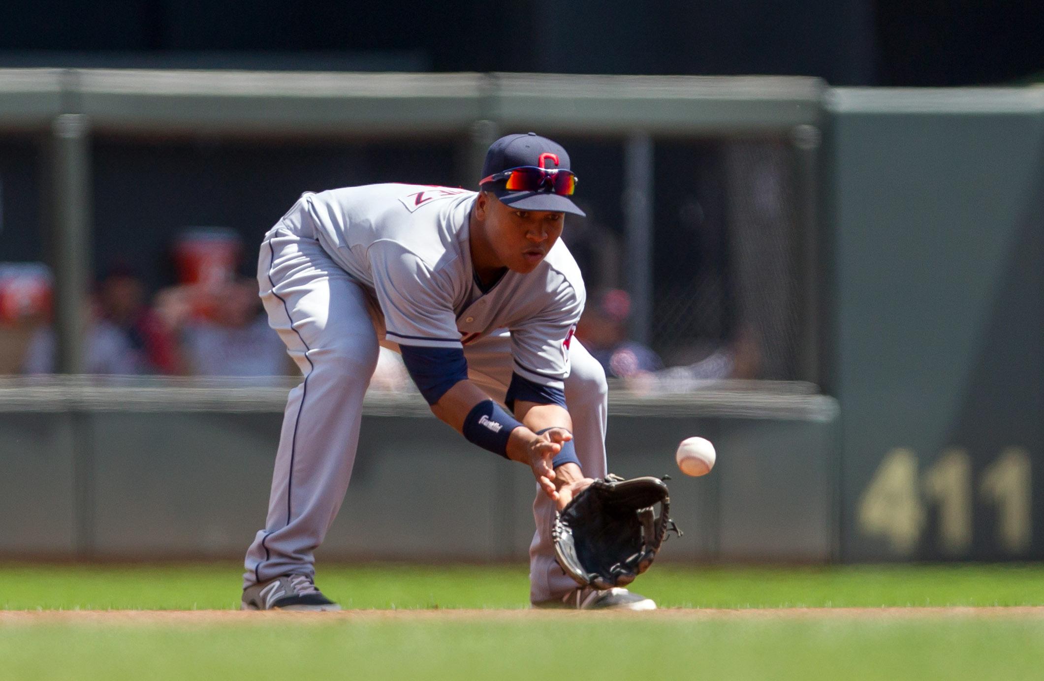 Jose Ramirez using his glove at short