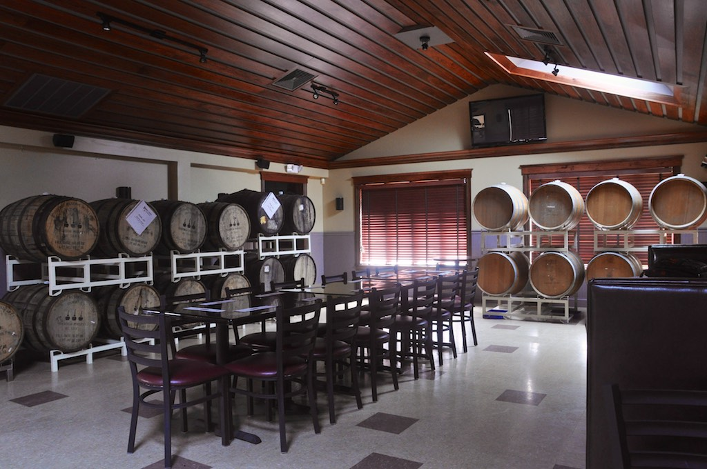 A dining room at Fire N Brew doubles as a barrel-aging facility for Hidden Cove.