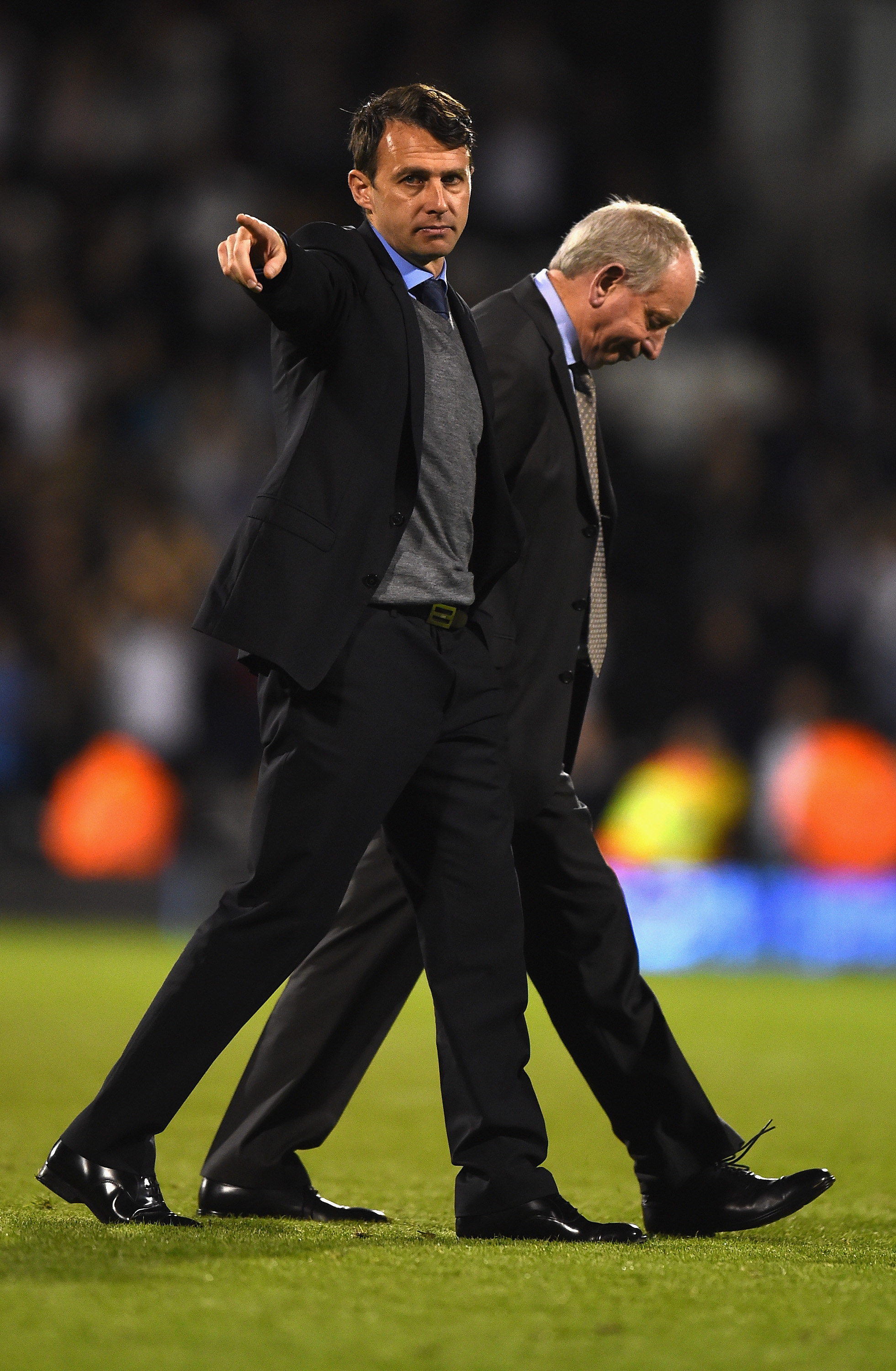 Out: Dougie Freedman and Lennie Lawrence trudge off the Craven Cottage pitch after their final match in charge of Bolton