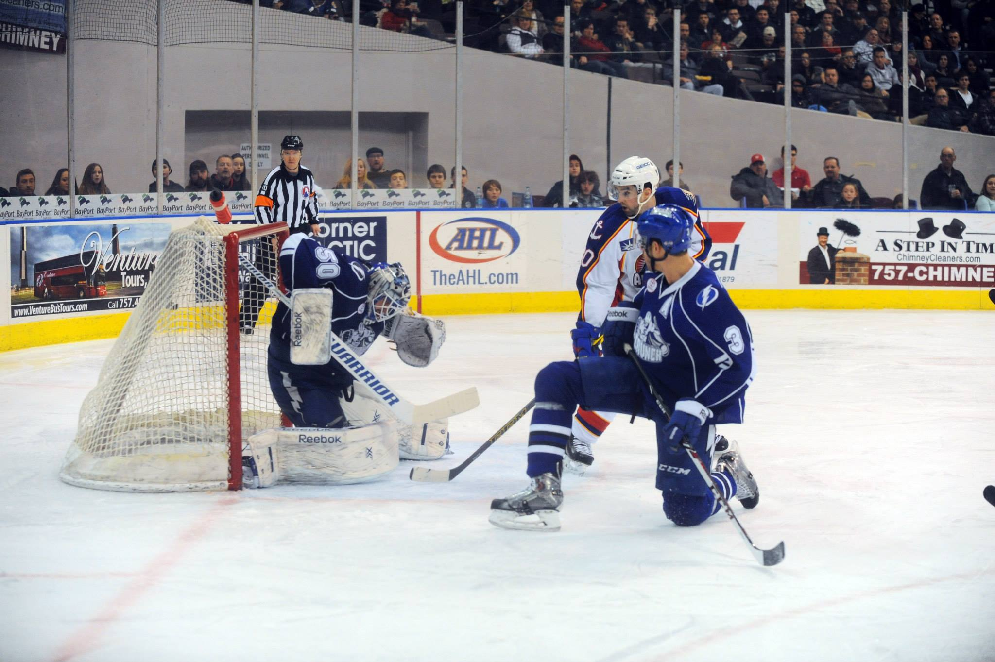 William Karlsson's first of two goals against the Syracuse Crunch last Saturday, Feb 14, 2015 kicks up the goaltender's water bottle