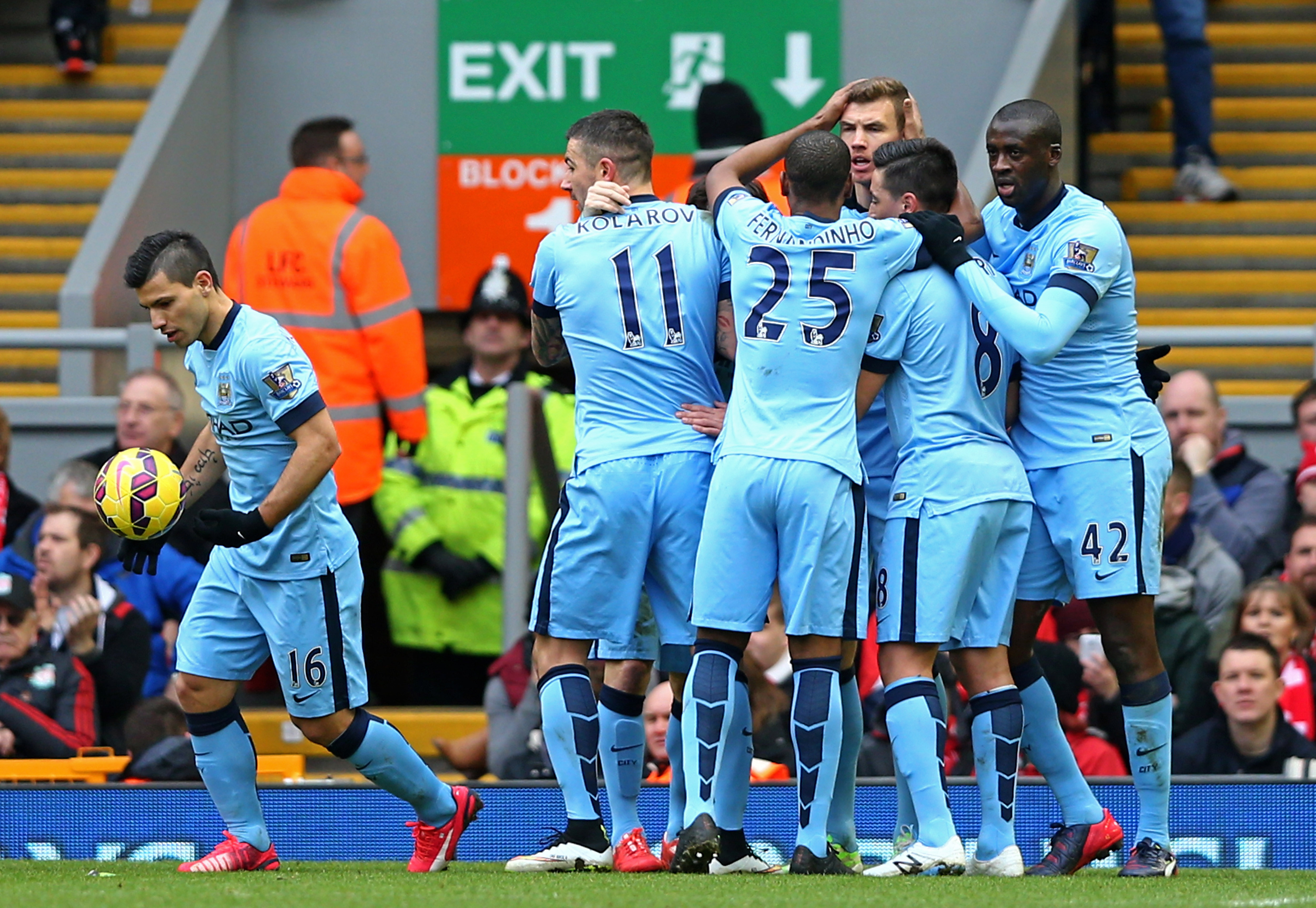 Edin Dzeko (3rd R) of Manchester City is congratulated by teammates after scoring a goal to level the scores at 1-1 during the Barclays Premier League match between Liverpool and Manchester City at Anfield on March 1, 2015 in Liverpool, England.
