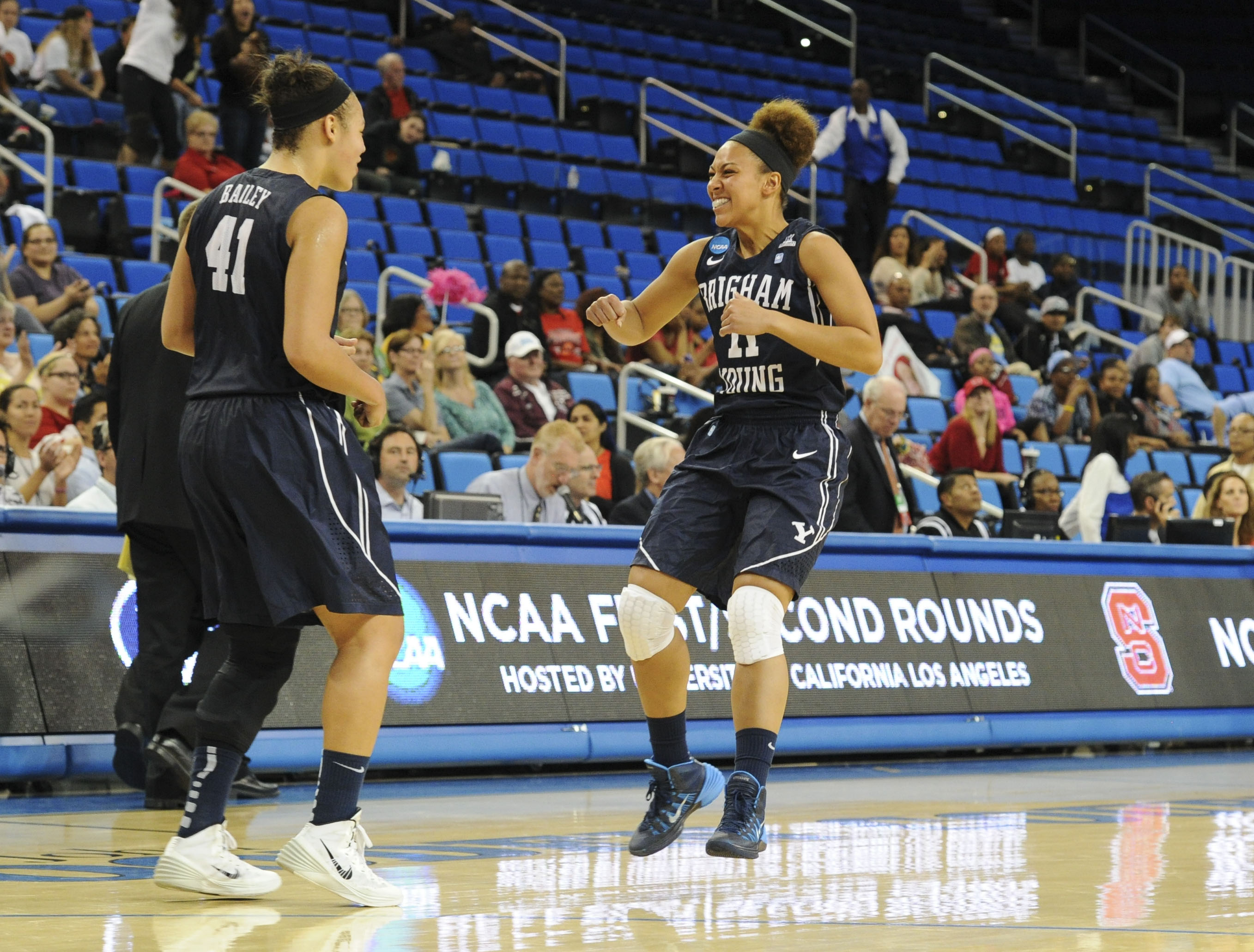 Morgan Bailey and Xojian Harry celebrate after a win in the NCAA Tournament last year.