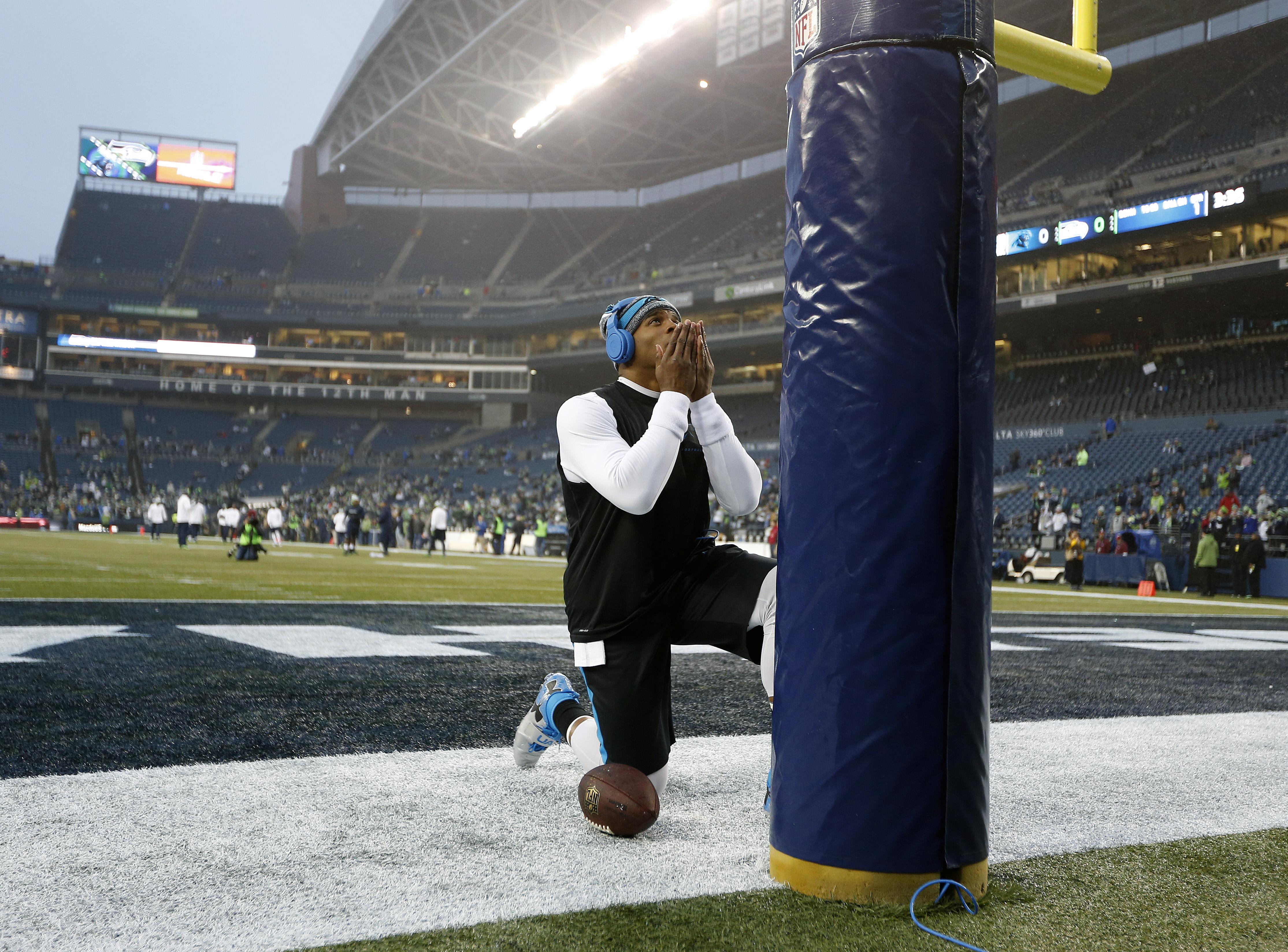Cam Newton prays towards Mecca