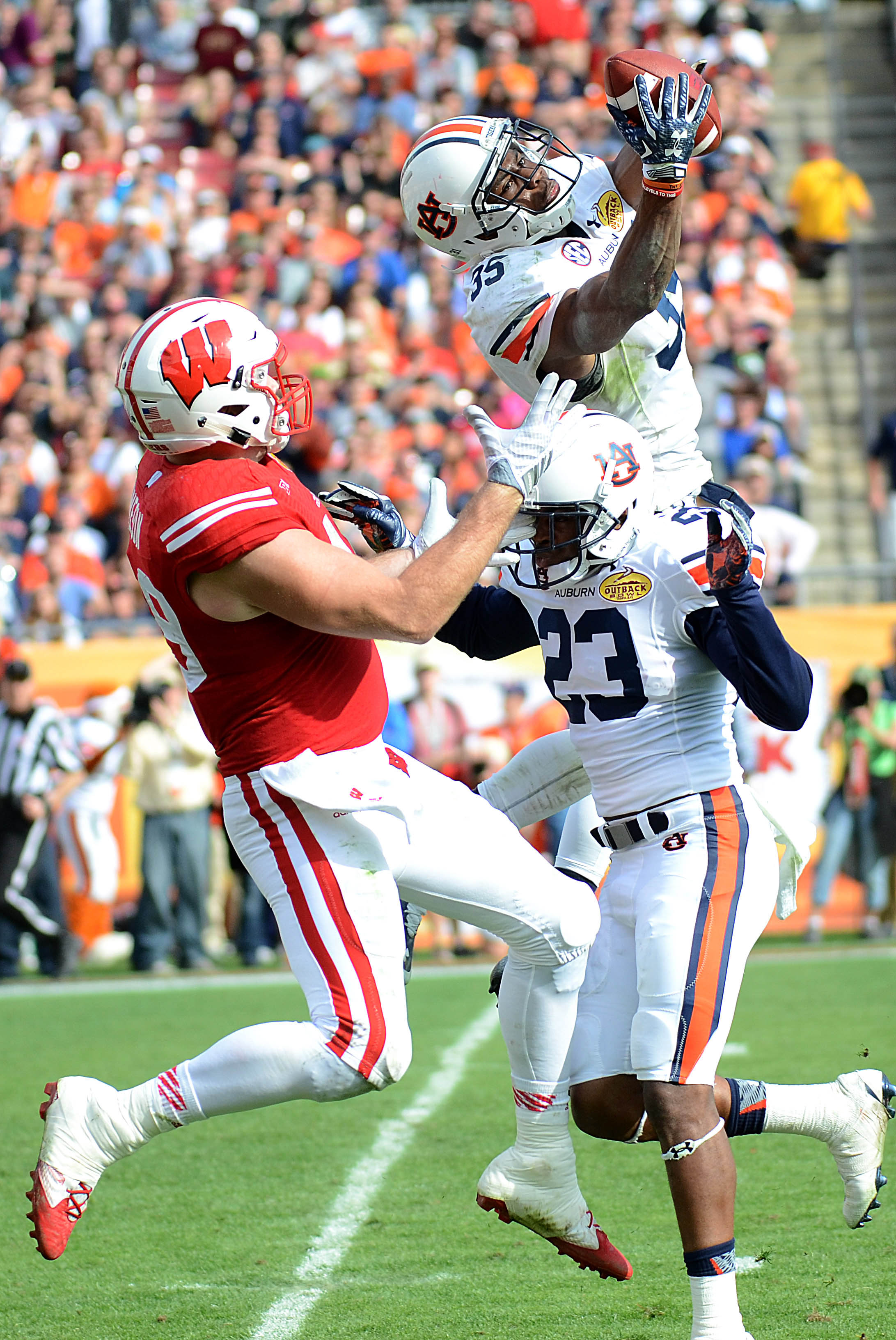Rudy Ford defends the Wisconsin receiver while Jermaine Whitehead pulls down the INT. One of his six.