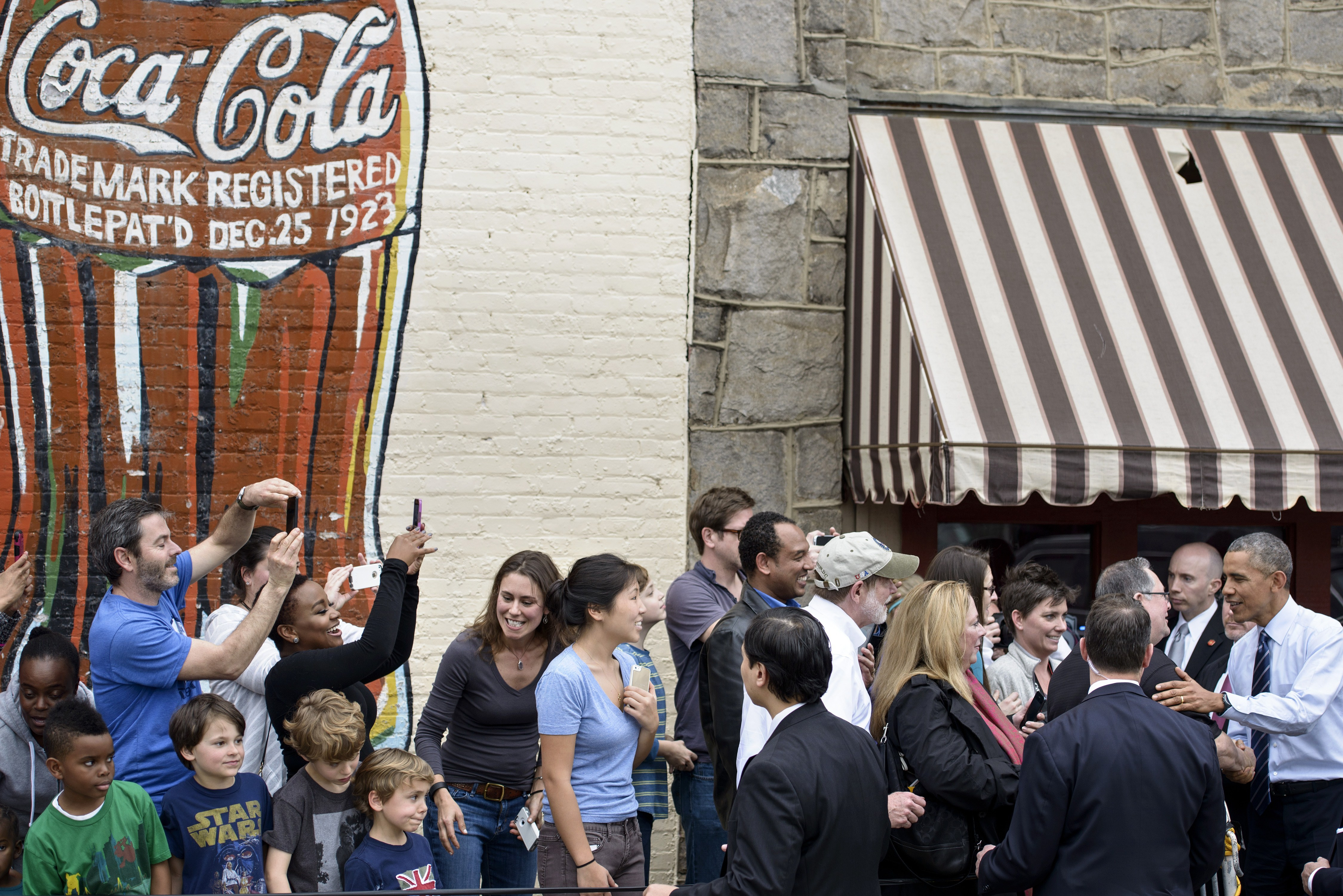 President Barack Obama greets the crowd at Manuel's Tavern.