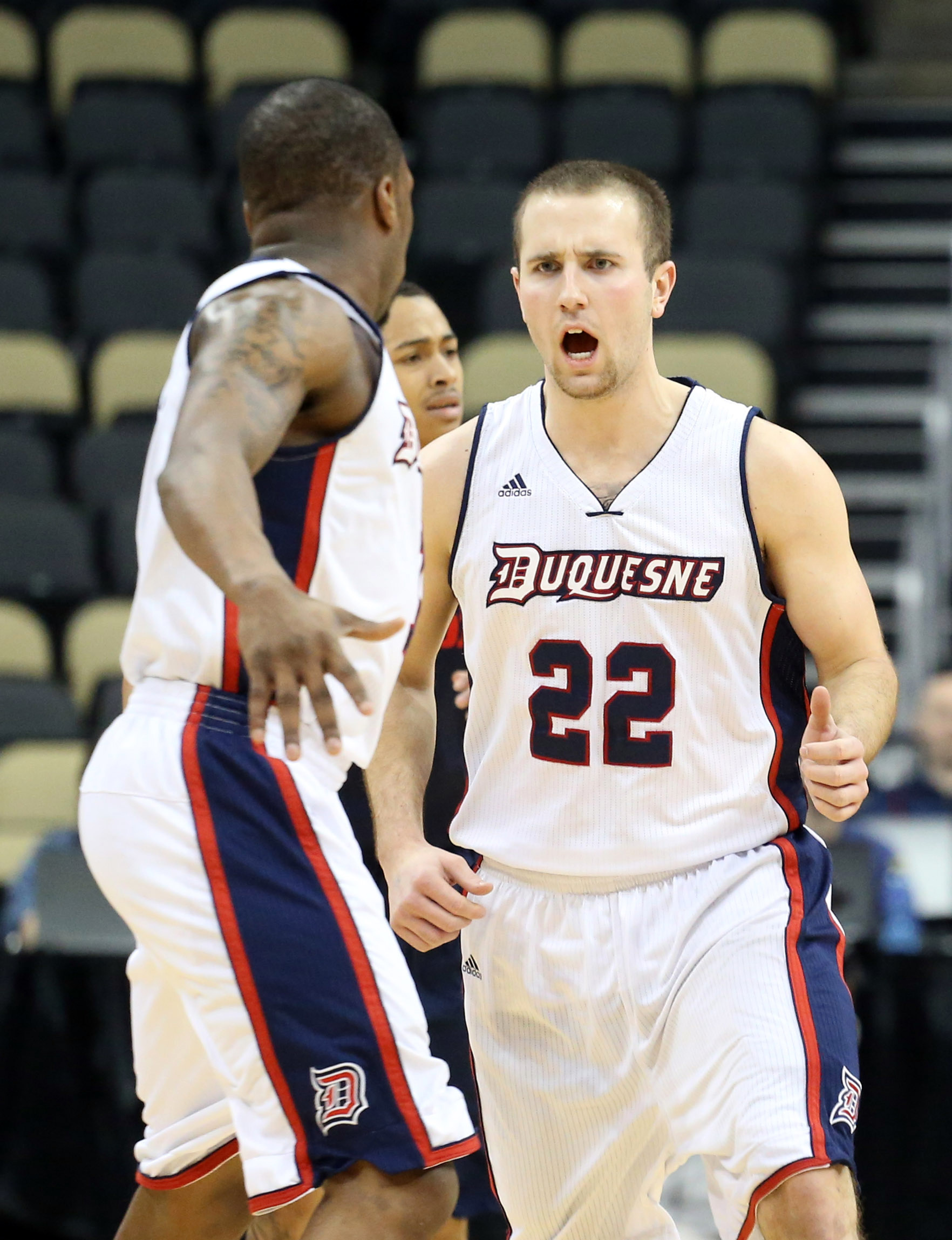 Duquesne's Micah Mason (#22) who scored 19 points in their victory against the Saint Louis Billikens in the Atlantic 10 Conference Tournament on Wednesday, March 11th, 2015