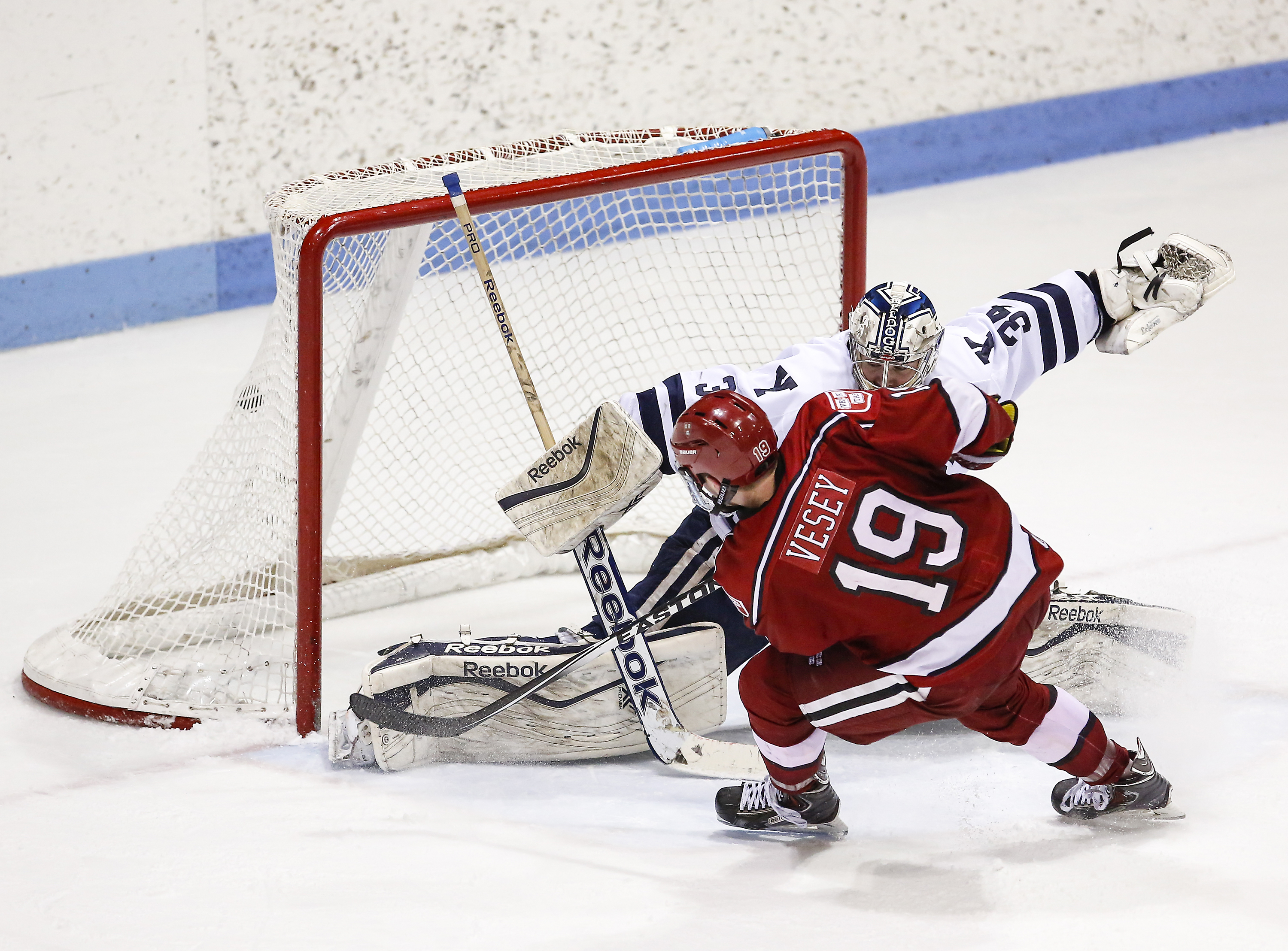 Jimmy Vesey's double overtime goal gave Harvard a 3-2 win over Yale on Sunday night in the ECAC Hockey Quarterfinals.