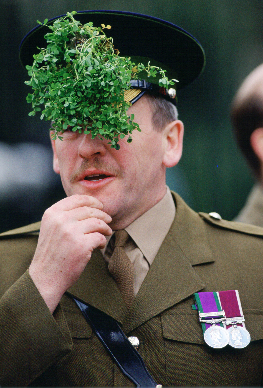 A soldier wears a St. Patrick's Day shamrock.
