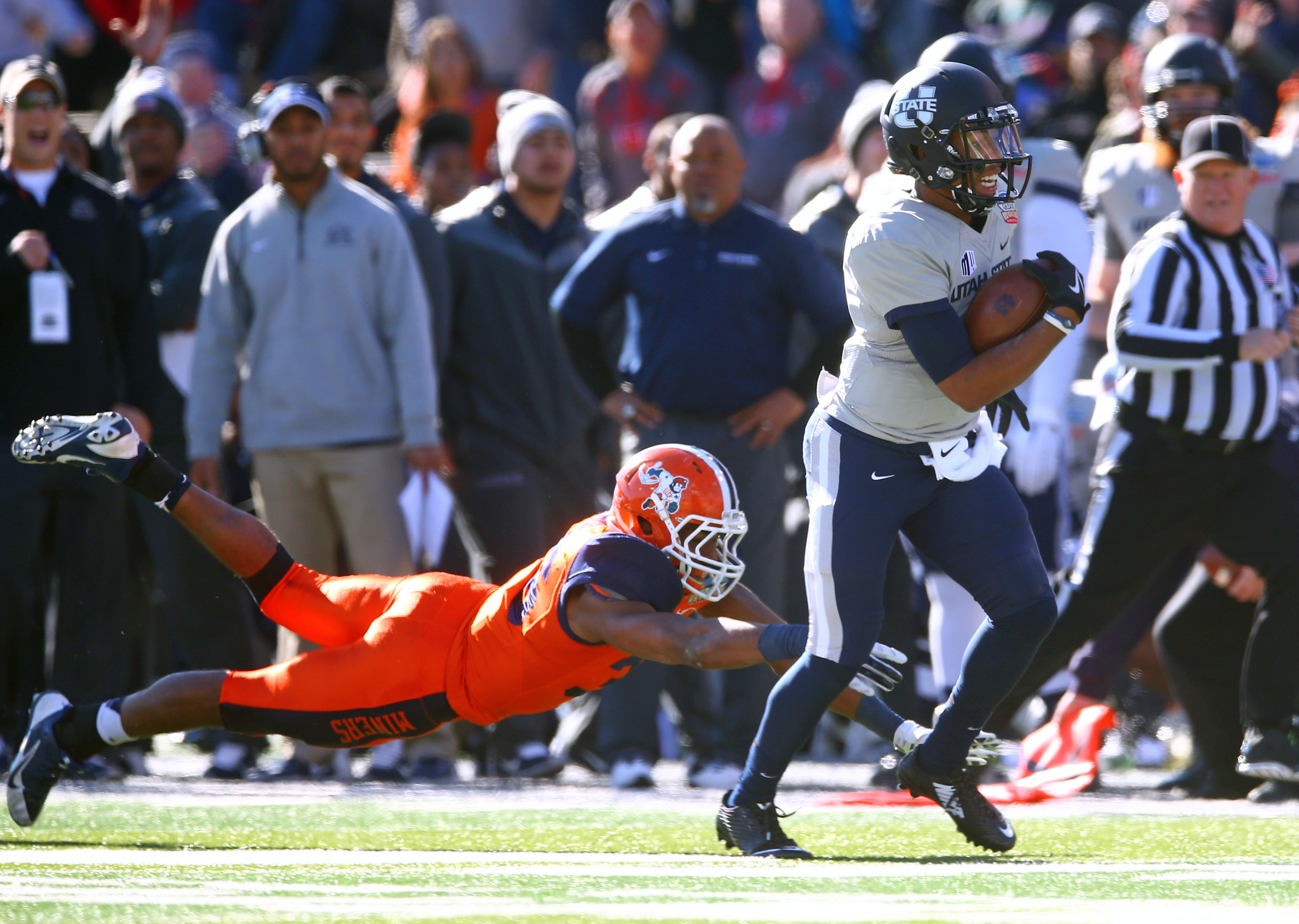 Kent Myers runs away from a UTEP defender in Utah State's New Mexico Bowl Victory