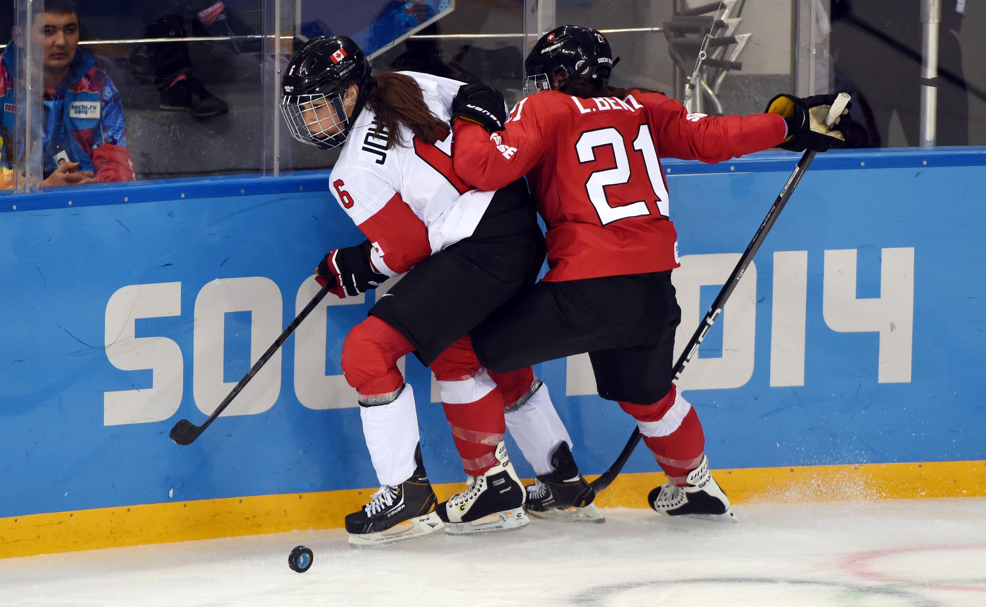 Rebecca Johnston (6 in white) and Team Canada are set to slam into the Women's World Championships in Malmo, Sweden, which start Saturday with play against Team USA.
