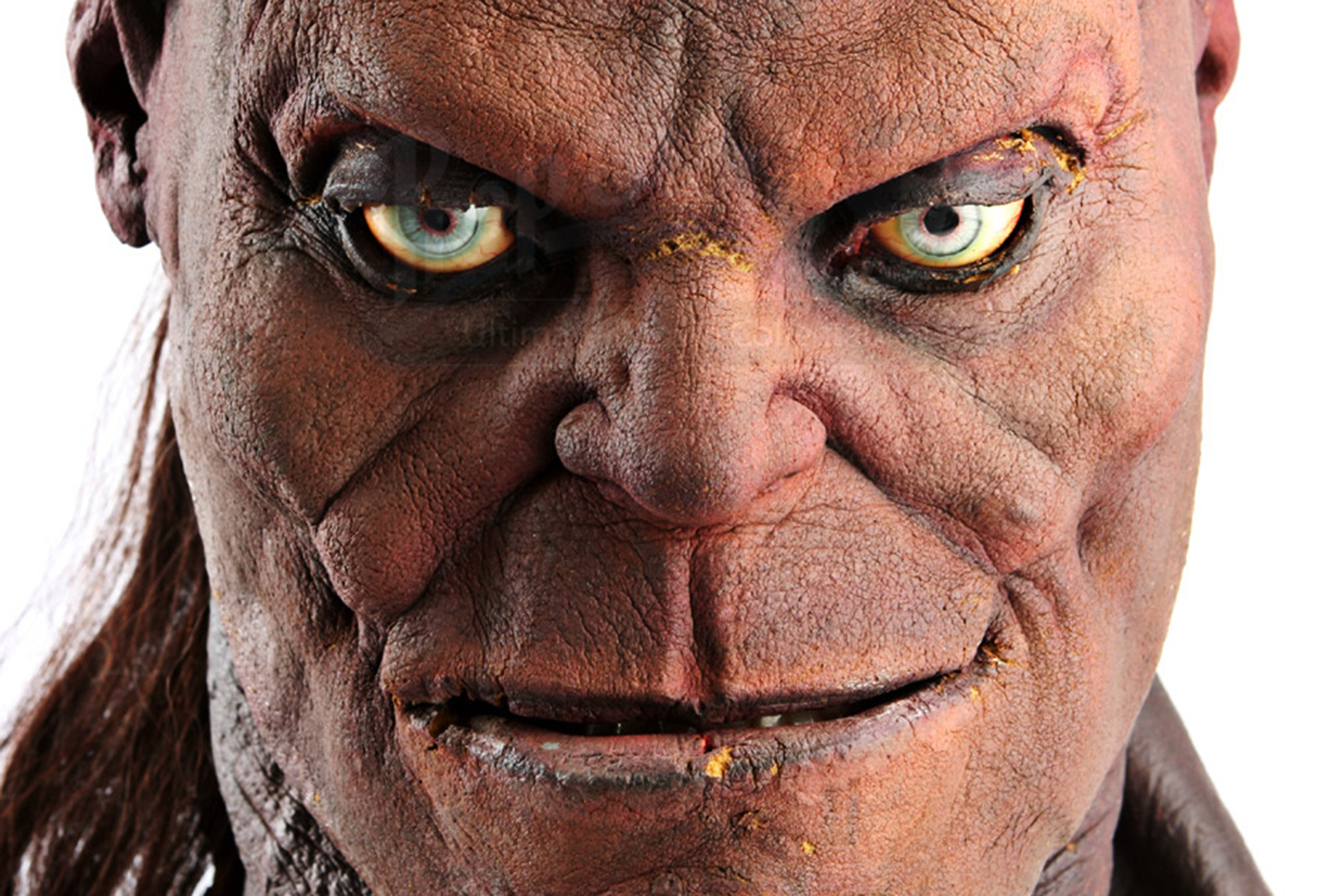 a close-up of a prop of the face of Goro from Mortal Kombat
