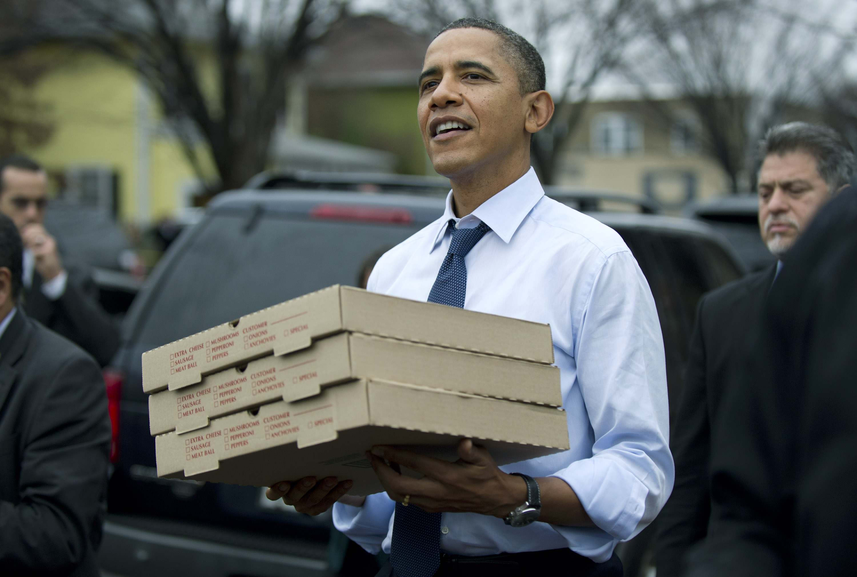 President Obama, who apparently enjoys pizza on occasion, pictured with several pizza boxes in Virginia in 2011.