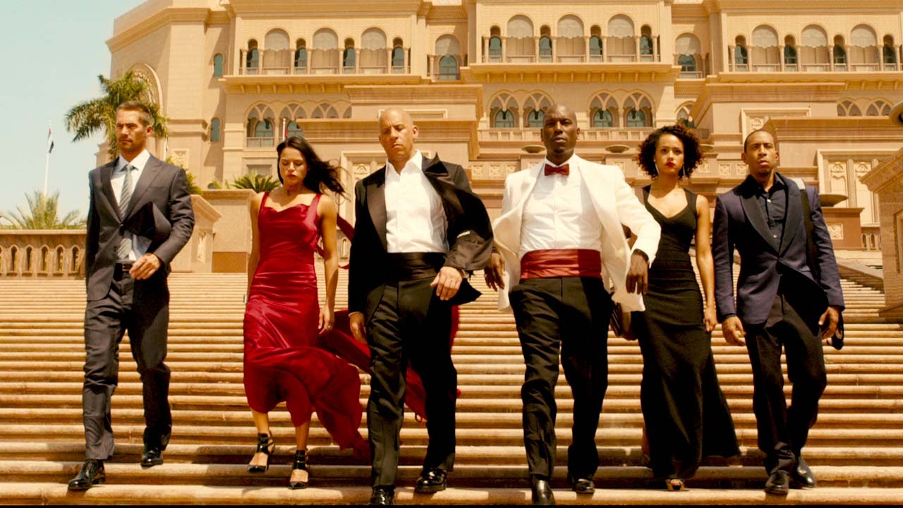 The cast of Furious 7 gets fancy as part of an elaborate scheme. These guys are always scheming elaborately.