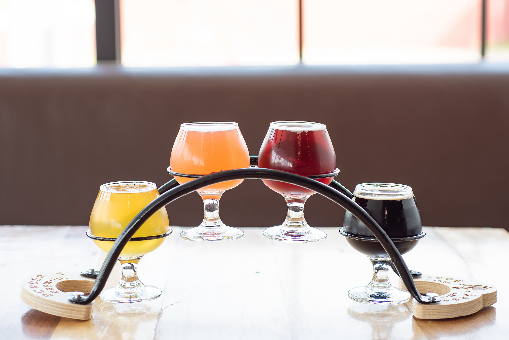 A flight of beers at Border X Brewing in Bell, California