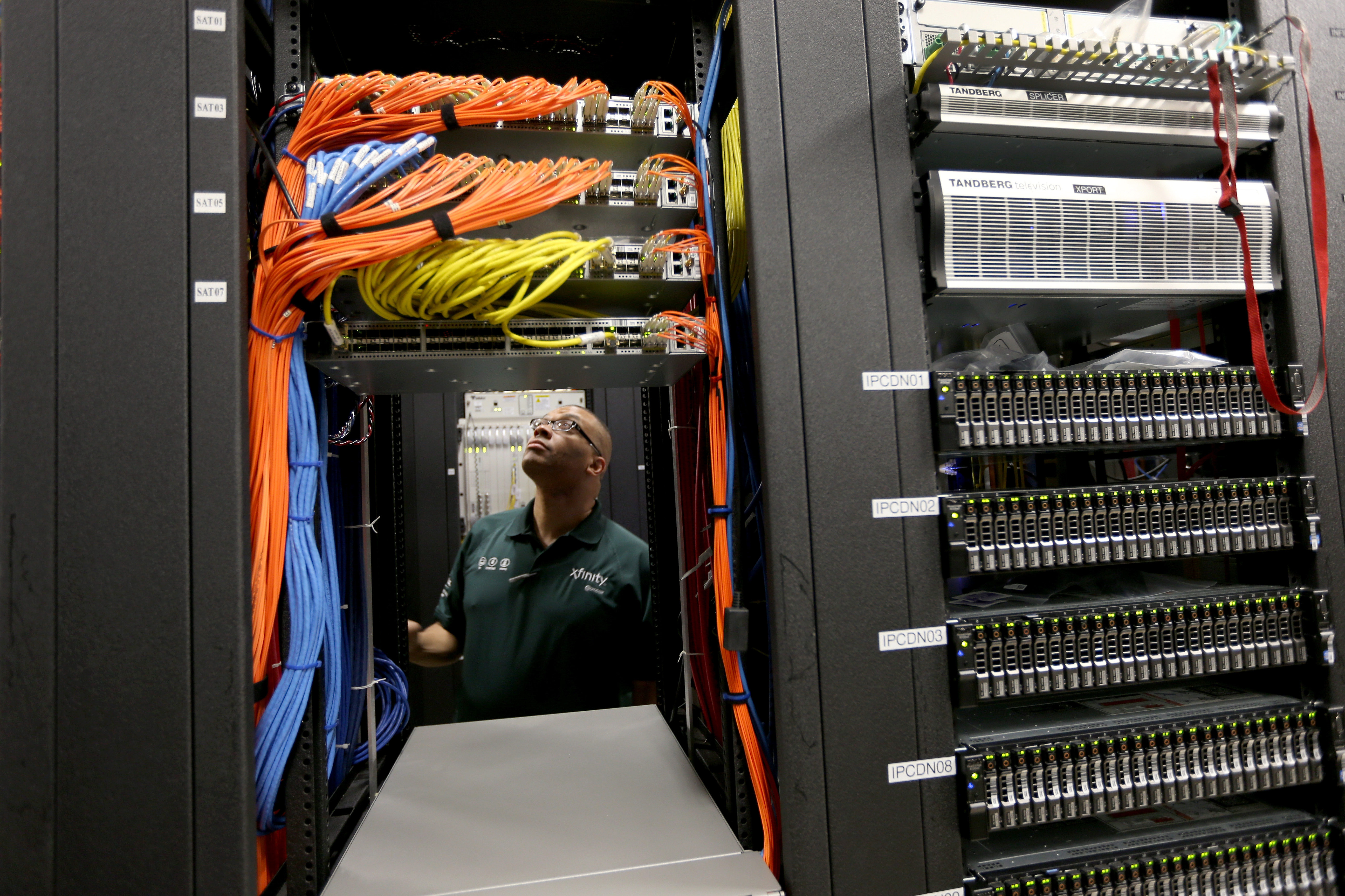 Warren Myers, a headend manager, stands among the cables and routers at a Comcast distribution center where the Comcast regional video, high speed data and voice are piped out to customers on February 13, 2014 in Pompano Beach, Florida.