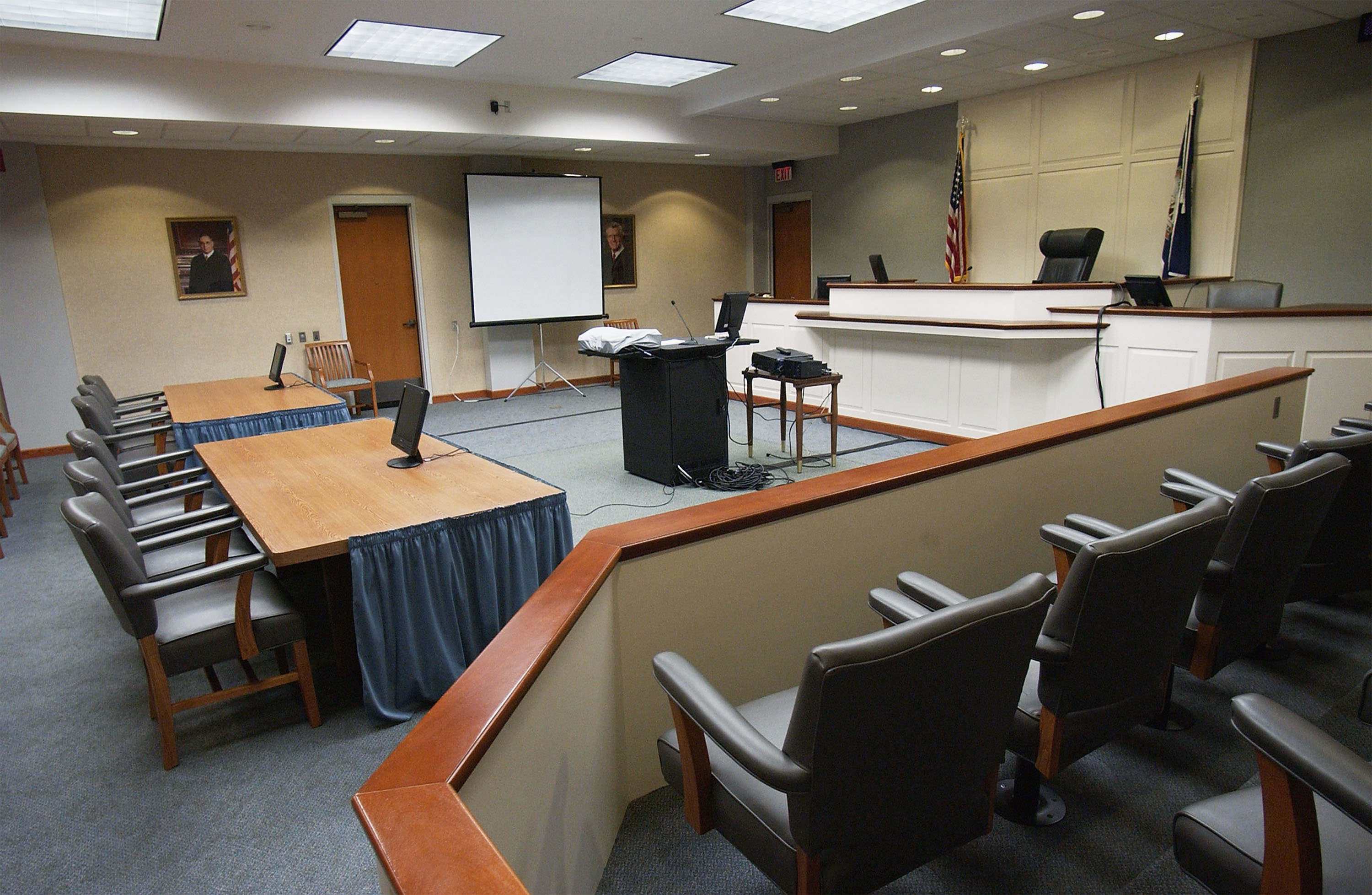 A view of the courtroom from a jury box.