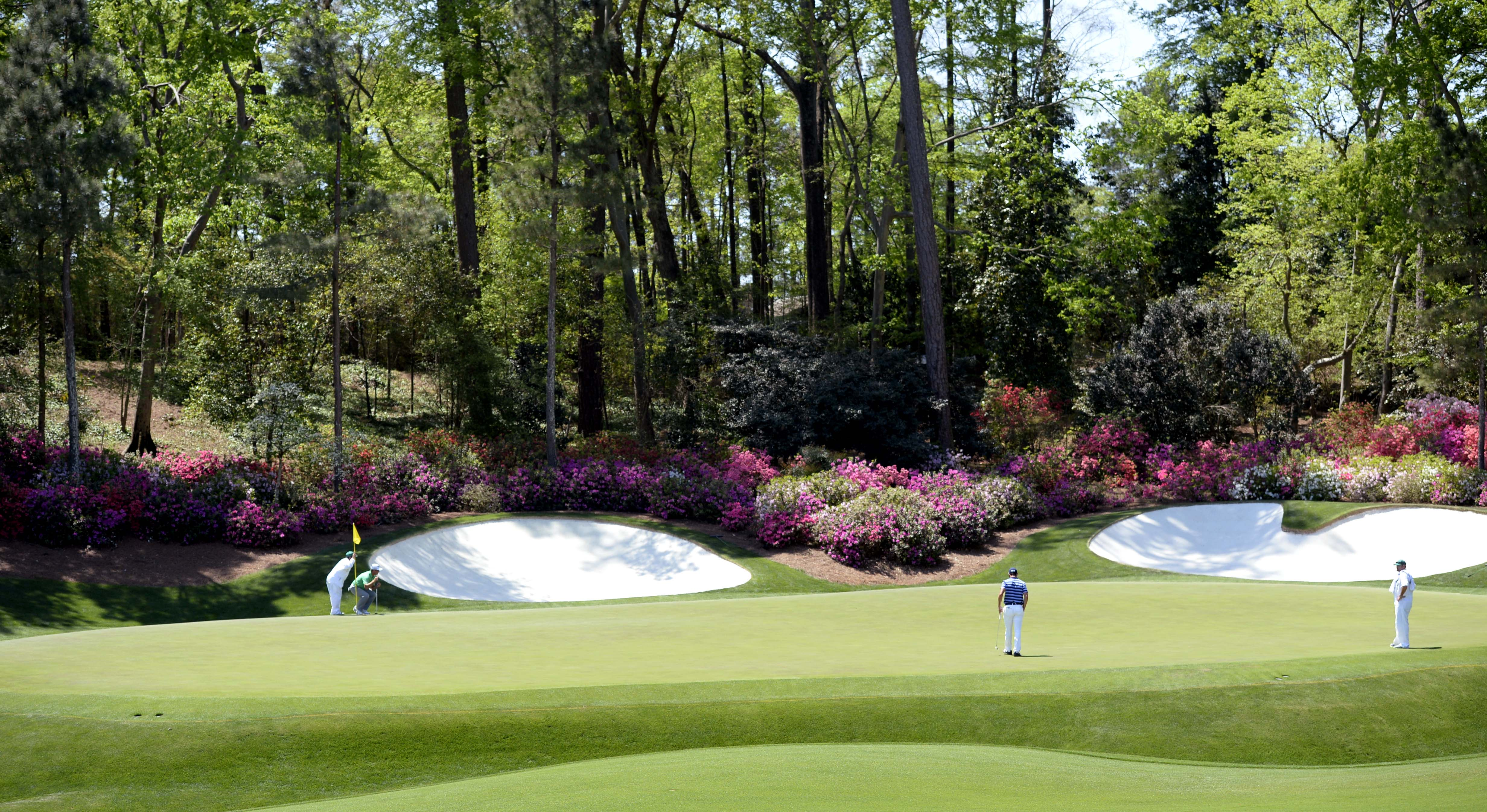 Do you know how long it took me to find a good picture of a hole at Augusta without Tiger Woods in it?
