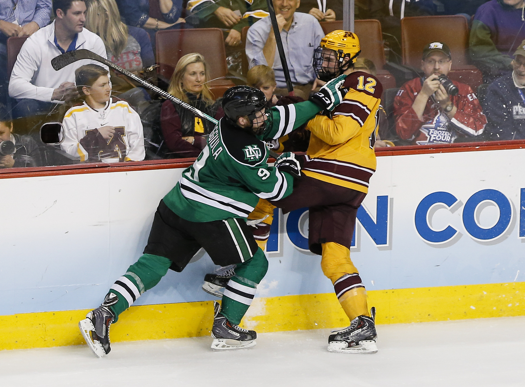 Tough play along the boards is a specialty of North Dakota