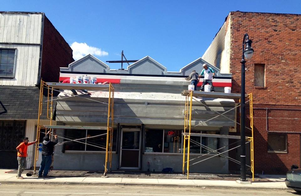 Crews work on updates to the facade at Columbo's Coney Island.