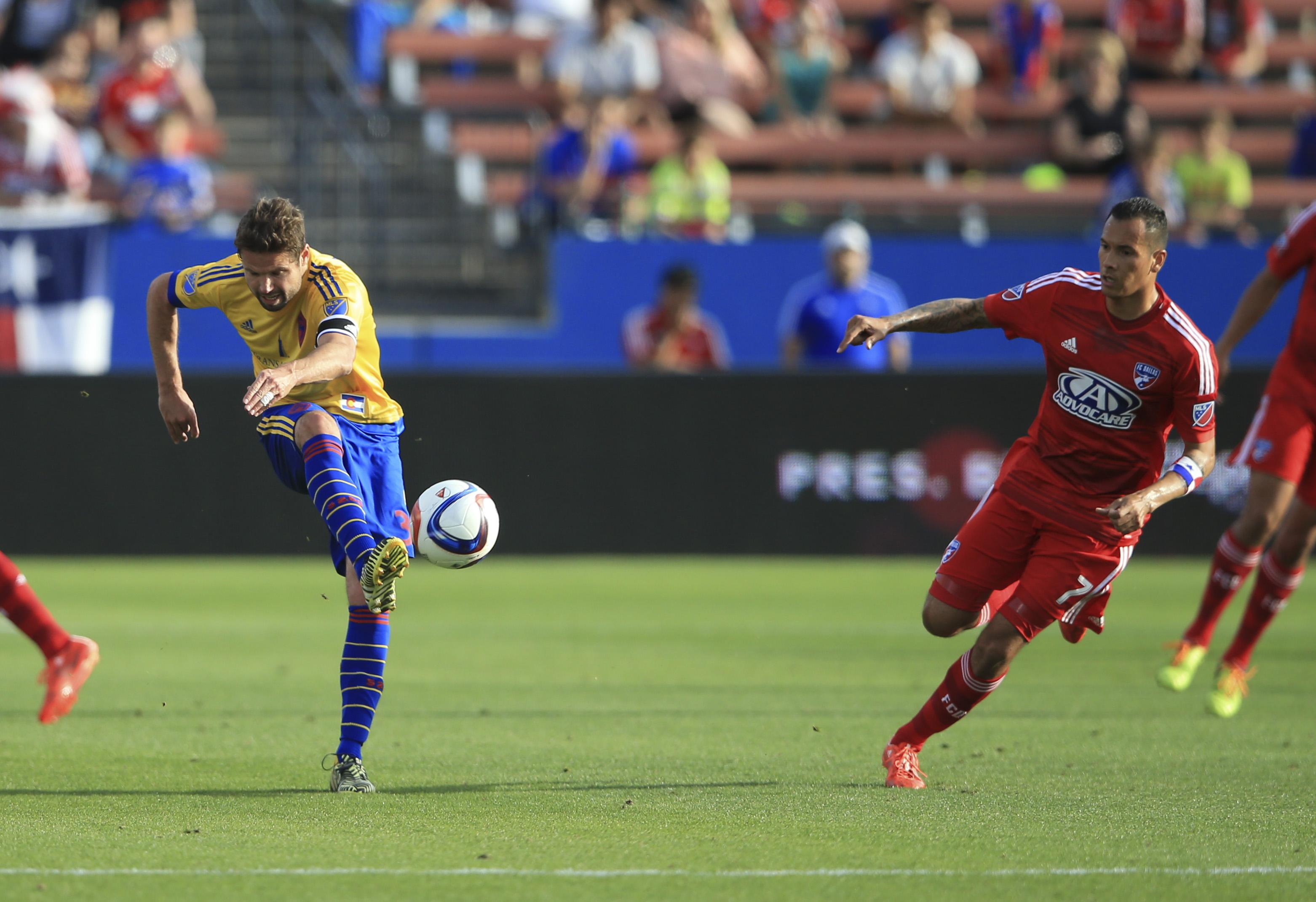 Captain Drew Moor kicks the ball upfield.
