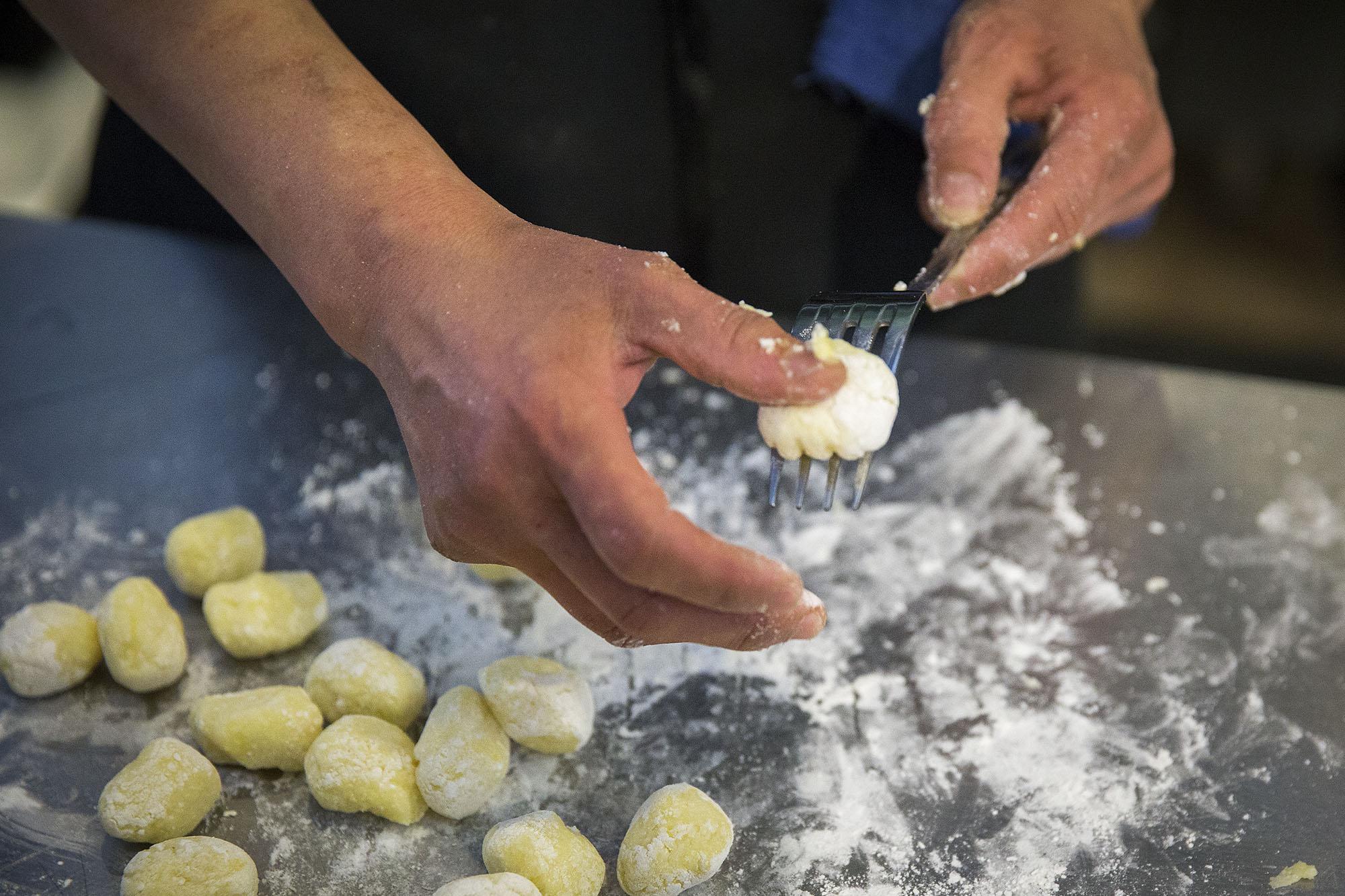 Lisa Nakamura rolls gnocchi off the back of a fork