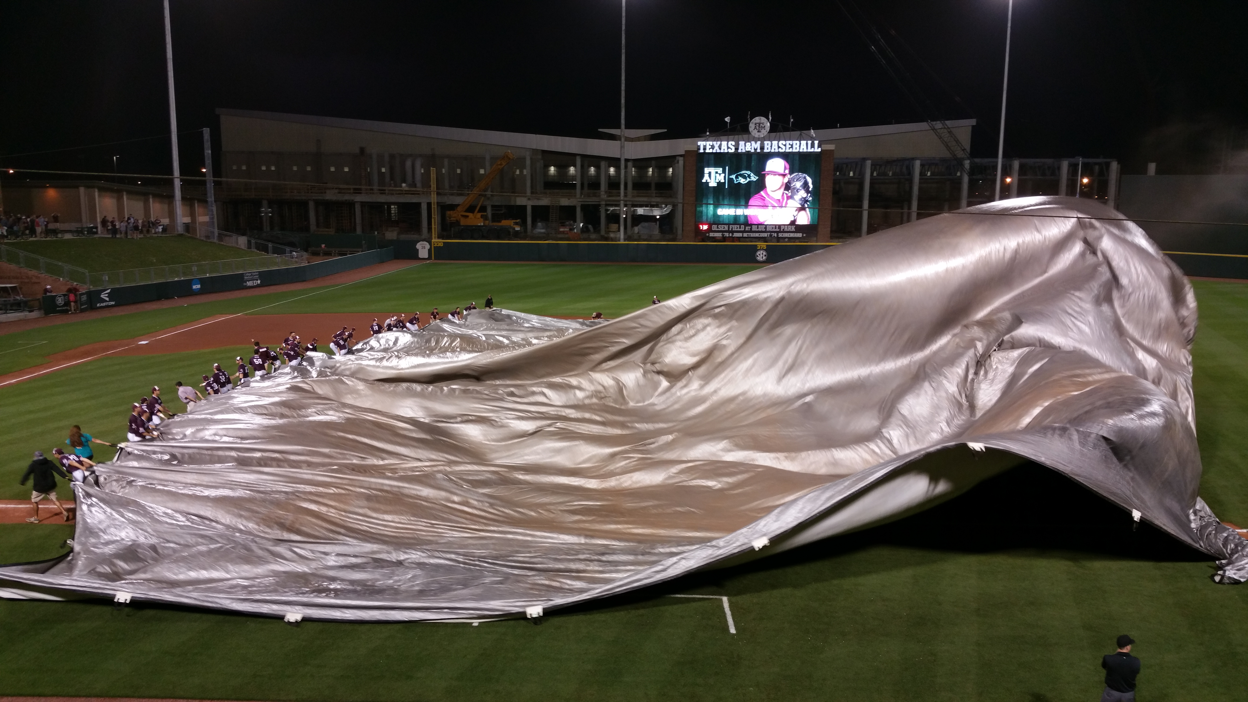 The winds picked up enough for the ground crew to need a bit of help from the team to get the tarp down.